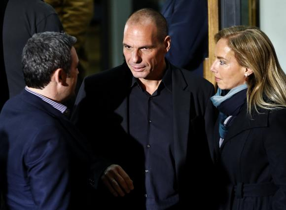 Greek economist Varoufakis is seen outside the Syriza party headquarters in Athens