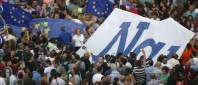 The word 'Yes' in Greek is seen on a banner during a pro-Euro rally in front of the parliament building, in Athens, Greece, June 30, 2015.   REUTERS/Jean-Paul Pelissier