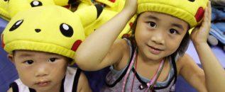 Ami Kobayashi (R) and her younger brother Akio put on Pokemon caps during Pokemon Festa 2005 in Yoko..