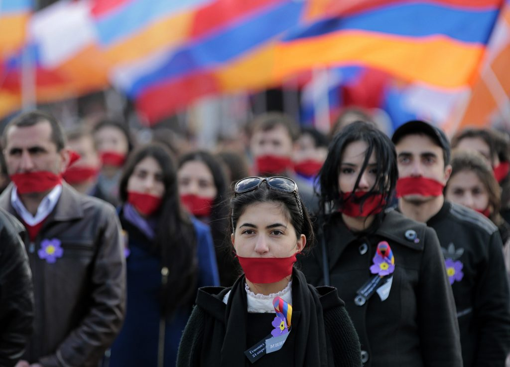 epa04719044 Armenian people attend a rally in Moscow, Russia, 24 April 2015 to mark the 100th anniversary of the mass killings of Armenians under the Ottoman Empire. On 24 April 1915 the Ottoman Empire started the extermination of its minority Armenian population. A total number of between one and 1.5 million people are believed were killed during the massacre. EPA/MAXIM SHIPENKOV
